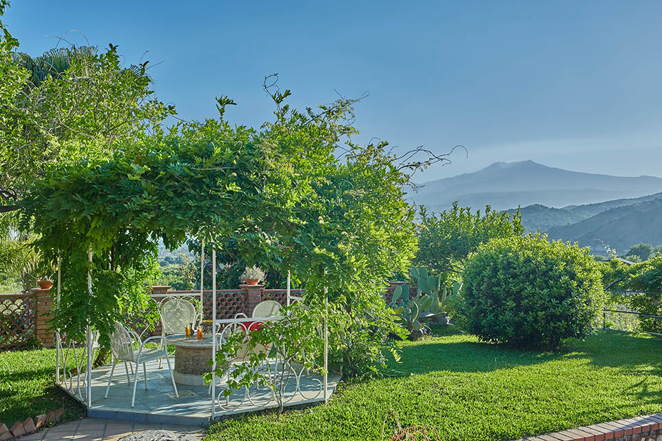 Villa Calipso, the garden with view of the Etna volcano