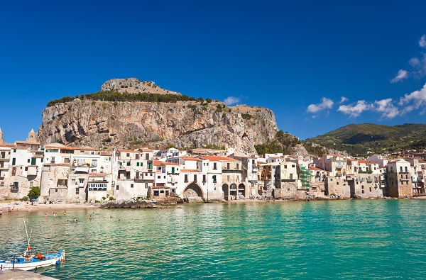 La Rocca seen from the harbour in Cefalù
