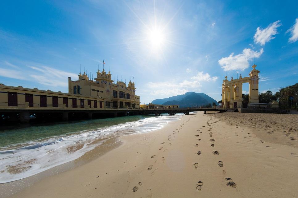 The beach and a pier building at Mondello